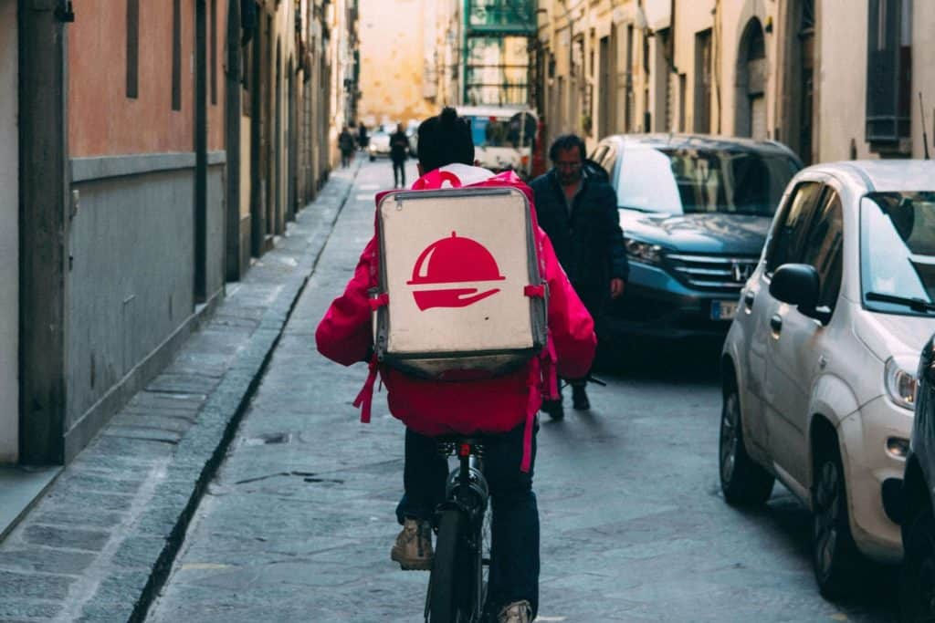 A person delivering food on a bike