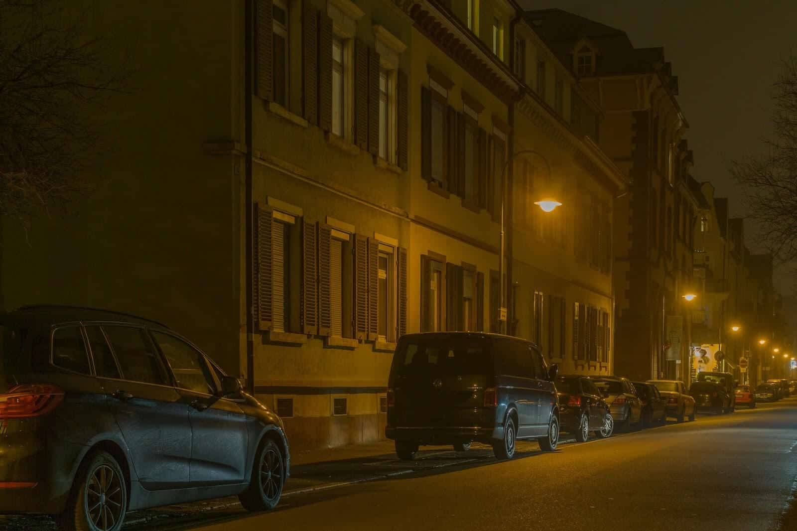 Cars parked on a dark street